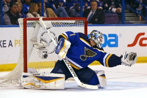 St. Louis Blues goalie Brian Elliott makes a glove save on a shot by the Toronto Maple Leafs during the first period of an NHL hockey game on Jan. 17, 2015, in St. Louis. (Billy Hurst / AP Photo)