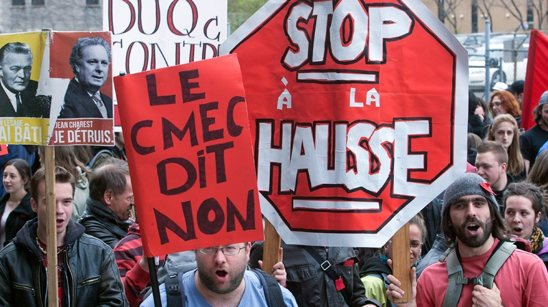 Students protest against tuition fee hikes in front of the education ministry office in Montreal, Thursday, April 26, 201. (Ryan Remiorz / THE CANADIAN PRESS)