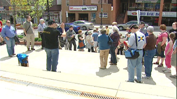 People take part in Jane's Walk on Sunday, May 6, 2012.