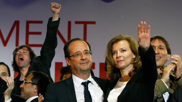 French president-elect Francois Hollande reacts to supporters with his companion Valerie Trierweiler while celebrating his election victory in Paris, France, Sunday, May 6, 2012. (AP / Francois Mori)