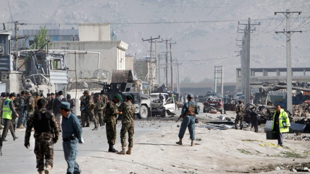 Damaged vehicles are seen at the scene of militants' attack in Kabul, Afghanistan, Wednesday, May 2, 2012. (AP / Musadeq Sadeq)