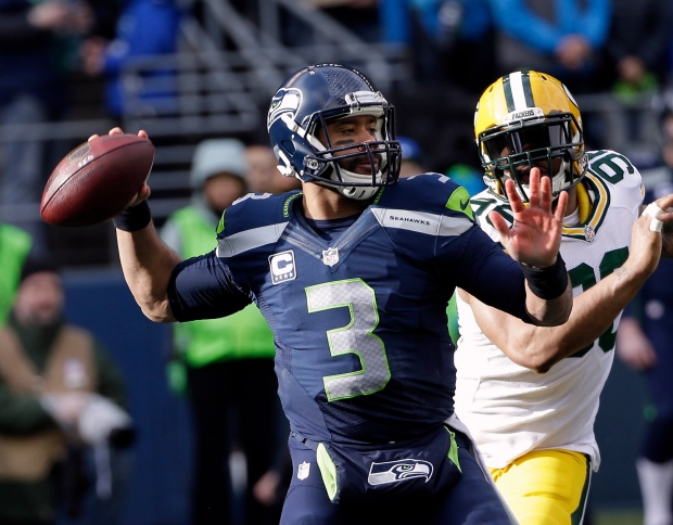 fa334a1f6 Seattle Seahawks quarterback Russell Wilson drops back to pass during the  first half of the NFL football NFC Championship game against the Green Bay  Packers ...