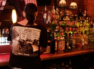 In this May 29, 2014 file photo, a bartender works behind the bar at an establishment in New York. New York is considering raising the sub-minimum to $7 an hour to decrease the reliance on tips. (AP / Richard Drew, File)