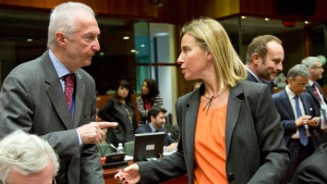EU Counter-Terrorism chief Gilles de Kerkhove, left, gestures while speaking with European Union High Representative Federica Mogherini, center, during a meeting of EU foreign ministers in Brussels on Monday, Jan. 19, 2015. (AP / Virginia Mayo)