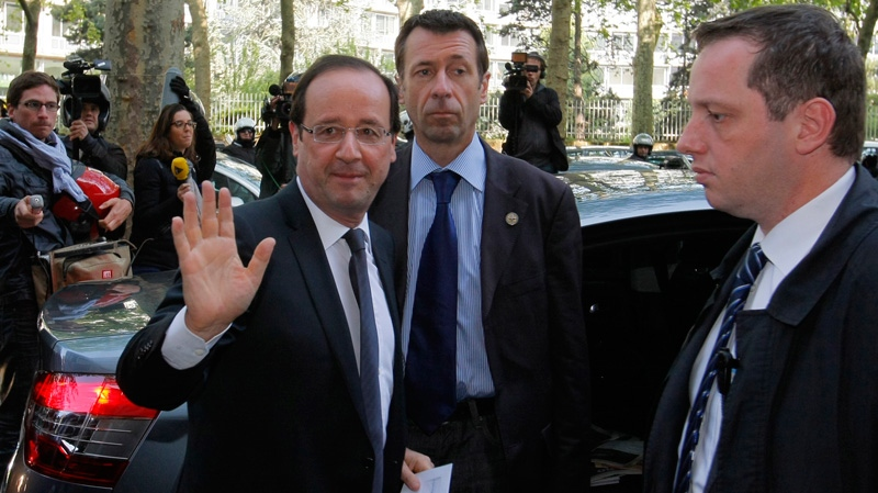 President-elect Francois Hollande, left, waves as he arrives at the Socialist Party headquarters in Paris, Monday, May 7, 2012. (AP / Michel Spingler)