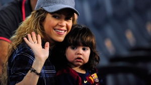 Singer Shakira, left, with her son Milan in Barcelona, Spain, on Oct. 18, 2014. (AP / Manu Fernandez)