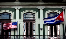 Cuban and U.S. flags on Havana hotel