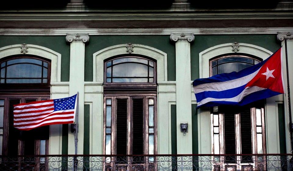 A Cuban and U.S. flag wave from the balcony of the Hotel Saratoga where a U.S. Congressional delegation is staying in Havana, Cuba, Monday, Jan. 19, 2015. (AP / Ramon Espinosa)