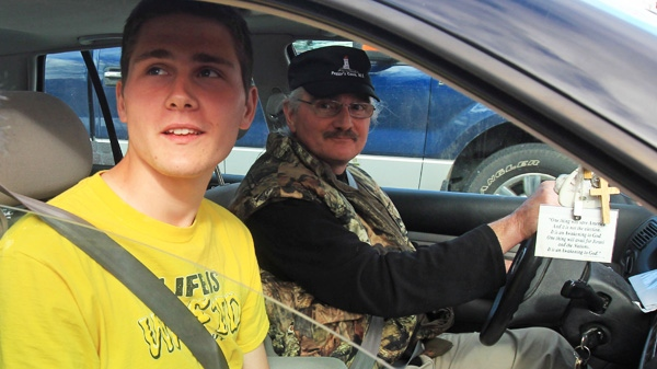 William and his father John Swinimer leave Forest Heights Community School in Chester Basin, Nova Scotia, on Monday, May 7, 2012 wearing his 'Life is Wasted Without Jesus' T-shirt.  (Mike Dembeck / THE CANADIAN PRESS)