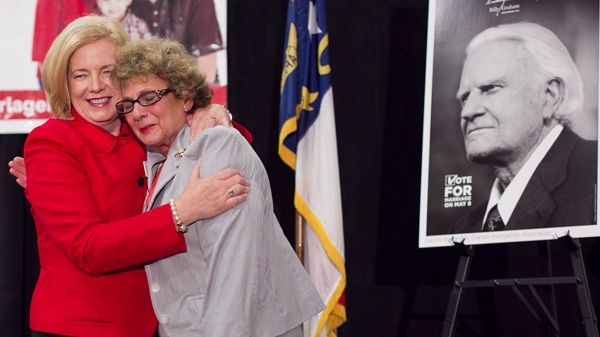 Mary Frances Forrester, the wife of the late N.C. State Sen. James Forrester, right, embraces Tami Fitzgerald from Vote For Marriage NC as they celebrate the passage of Amendment One during an election night party Tuesday May 8, 2012 in Raleigh, N.C. (AP Photo/The News & Observer, Robert Willett)