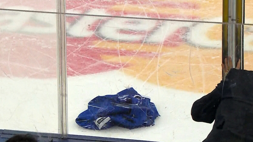 Three men are facing charges after jerseys were thrown onto the ice during play at Monday night's game between the Toronto Maple Leafs and the Carolina Hurricanes.