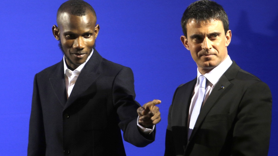 French Prime Minister Manuel Valls, right, awards citizenship to Lassana Bathily during a ceremony in Paris, Tuesday, Jan. 20, 2015. (AP / Christophe Ena)