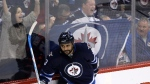 Winnipeg Jets' Dustin Byfuglien (33) celebrates after scoring against the Arizona Coyotes' during third period NHL hockey action in Winnipeg on Sunday, Jan. 18, 2015. (Trevor Hagan / THE CANADIAN PRESS)
