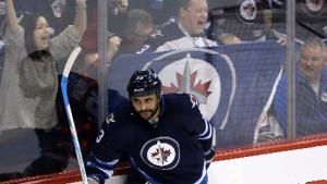 Winnipeg Jets' Dustin Byfuglien (33) celebrates after scoring against the Arizona Coyotes' during third period NHL hockey action in Winnipeg on Sunday, Jan. 18, 2015. (Trevor Hagan / THE CANADIAN PRESS)