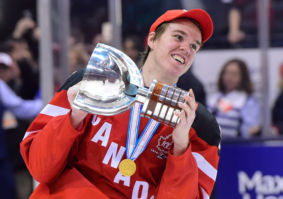 Team Canada's Connor McDavid skates with the trophy following his team's gold medal victory over Team Russia at the IIHF World Junior Championship in Toronto on Jan. 5, 2015. (Frank Gunn / THE CANADIAN PRESS)