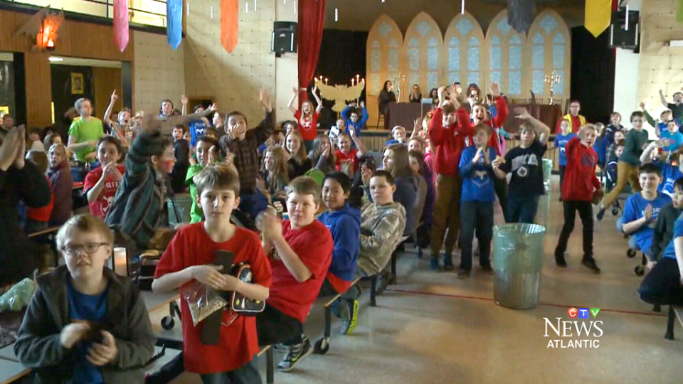 Riverview Middle School students celebrate in their Hogwarts-inspired cafeteria, modelled after the dining hall in 'Harry Potter.'