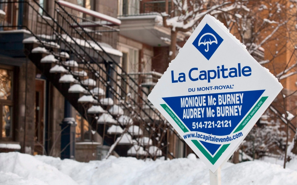 A real estate sign is seen in front of a Montreal home, Monday, Jan. 17, 2011. (Paul Chiasson / THE CANADIAN PRESS)