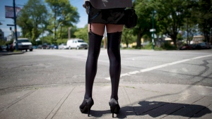 A sex trade worker is pictured in downtown Vancouver, on June, 3, 2014. (Jonathan Hayward / THE CANADIAN PRESS)