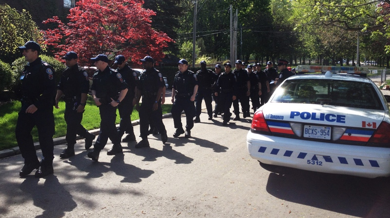 Toronto police officers prepare to fan out across Oriole Park to look for evidence in the city's latest murder on Wednesday, May 9, 2012. (Pat Darrah / CTV News)