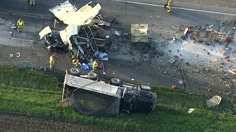 Emergency crews are on the scene in Stouffville following a crash between two dump trucks and a van, Wednesday, May 9, 2012.