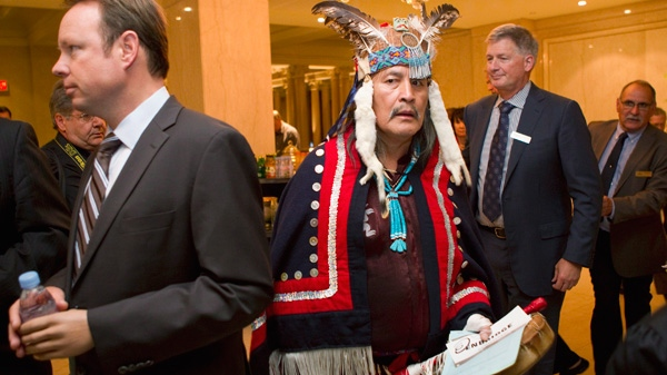 Martin Louie a First Nations leader from Nadieh, B.C arrives at the Enbridge AGM after leading a march of first nation protesters and their supporters through downtown Toronto as they continue their protest against proposed oil pipelines in Canada's west coast, on Wednesday May 9, 2012. (Chris Young / THE CANADIAN PRESS)