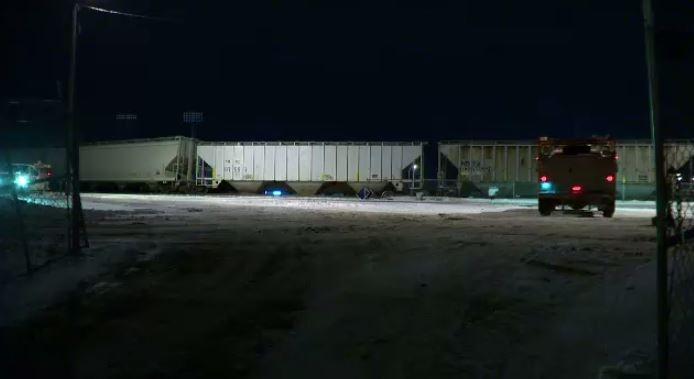 Emergency crews attend a train derailment in downtown Winnipeg Wednesday evening.