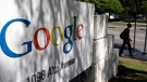 In this June 5, 2014 file photo, a man walks past a Google sign at the company's headquarters in Mountain View, Calif. (Marcio Jose Sanchez / AP Photo)