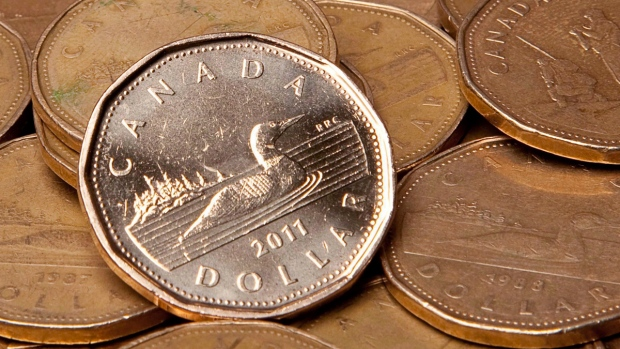 Canadian dollars in Vancouver, on Sept. 22, 2011. (THE CANADIAN PRESS / Jonathan Hayward)