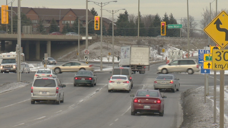 Traffic stops for a red light at Ottawa Street and Homer Watson Boulevard on Wednesday, Jan. 21, 2015.