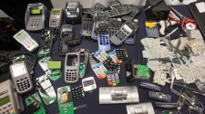 Some of the confiscated card scanners and technology are displayed at a news conference about the dismantling of a $100 million credit card fraud ring in Montreal, Wednesday, May 9, 2012. (Ryan Remiorz / THE CANADIAN PRESS)