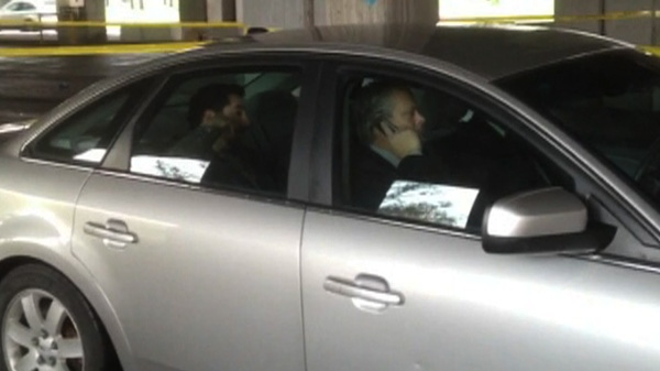 Debit card ring suspects are seen in police custody in Montreal on May 9, 2012.