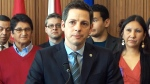 Winnipeg Mayor Brian Bowman speaks to reporters, in Winnipeg, Thursday, Jan. 22, 2015.