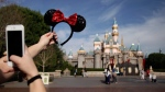 Taking a photo at Disneyland, in Anaheim, Calif., on Jan. 22, 2015 (AP / Jae C. Hong)