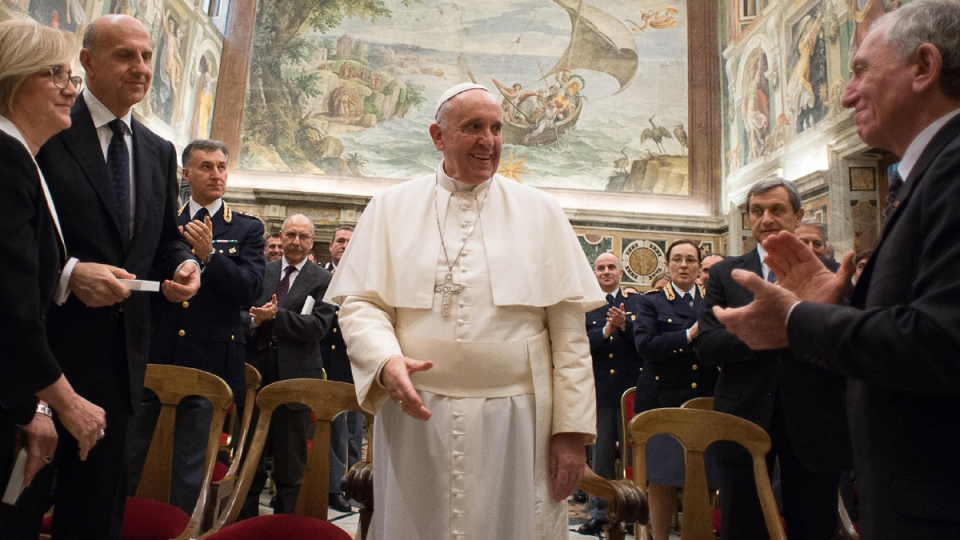 Pope Francis meets with members of Vatican security, on Jan. 22, 2015. (AP / L'Osservatore Romano)
