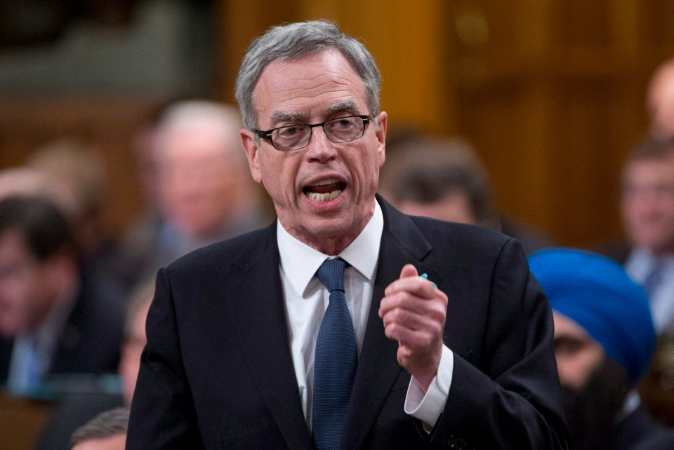 Finance Minister Joe Oliver responds during question period in the House of Commons on Parliament Hill in Ottawa on December 10, 2014. (Adrian Wyld / The Canadian Press)