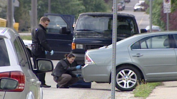 Police investigate after a woman was struck by a vehicle pulling out of a driveway in Guelph, Ont. on Wednesday, May 9, 2012.