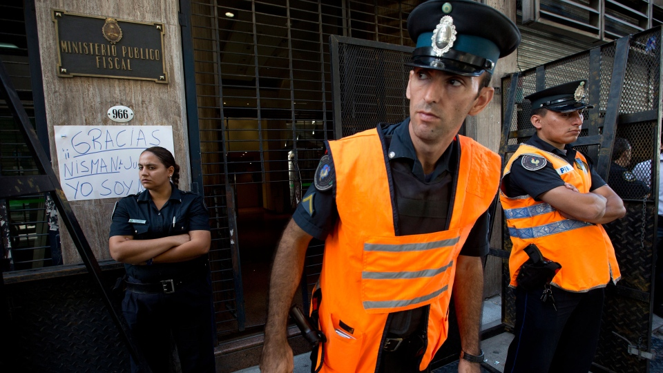 Police officers stand guard outside the prosecutor's office that leads the investigation into the death of Alberto Nisman, a prosecutor found dead in his apartment, in Buenos Aires, Argentina, Friday, Jan. 23, 2015. (AP / Rodrigo Abd)