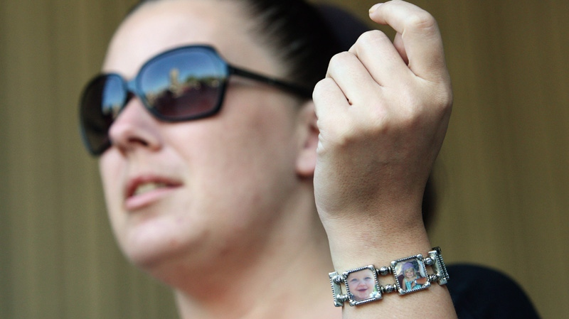 Tara McDonald, mother of Victoria (Tori) Stafford shows her new bracelet with photos of Tori on a break at the courthouse for the Michael Rafferty murder trial in London, Ont., Friday, May 11, 2012. (Dave Chidley / THE CANADIAN PRESS)