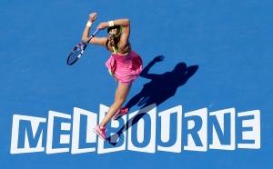 Eugenie Bouchard of Canada follows through on a shot to Irina-Camelia Begu of Romania during their fourth round match at the Australian Open tennis championship in Melbourne, Australia, Sunday, Jan. 25, 2015. (AP / Lee Jin-man)