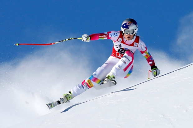 Lindsey Vonn speeds down the course during an alpine ski, women's World Cup downhill in St. Moritz, Switzerland, Saturday, Jan. 24, 2015. (AP Photo/Marco Trovati)