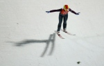 Canada's Taylor Henrich lands after an attempt during a women's normal hill ski jumping training at the 2014 Winter Olympics on Monday, Feb. 10, 2014, in Krasnaya Polyana, Russia. (AP / Gregorio Borgia)