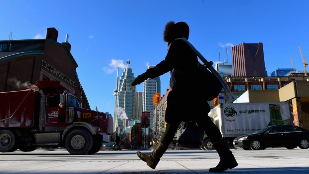 In this file photo, a woman walks in downtown Toronto during an extreme cold weather alert. (Frank Gunn / THE CANADIAN PRESS)