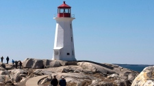 Tourists visit the lighthouse at Peggy's Cove, N.S. on Friday, April 8, 2011. (Andrew Vaughan / THE CANADIAN PRESS)