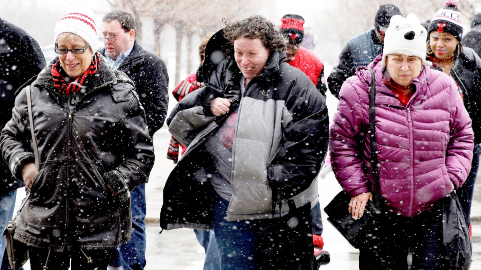 People walk through the snow in Chicago on Sunday, Jan. 25, 2015. (AP / Nam Y. Huh)