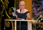 Patricia Arquette accepts the award for outstanding female actor in a supporting role for 'Boyhood' on stage at the 21st annual Screen Actors Guild Awards at the Shrine Auditorium on Sunday in Los Angeles on Jan. 25, 2015. (IInvision / Vince Bucci)