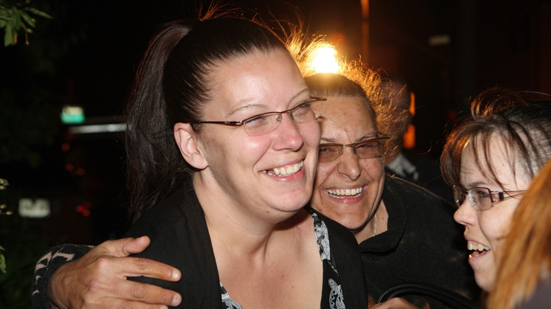 Tara McDonald, mother of slain Victoria Stafford celebrates with friends that Michael Rafferty was found guilty on all three charges at the murder trial in London, Ontario, Friday, May 11, 2012. (Dave Chidley / THE CANADIAN PRESS)