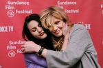 """Frances Bean Cobain, left, daughter of Kurt Cobain and executive producer of the documentary film """"Kurt Cobain: Montage of Heck,"""" embraces her mother and Cobain's widow Courtney Love at the premiere of the film at The MARC Theatre during the 2015 Sundance Film Festival on Saturday, Jan. 24, 2015, in Park City, Utah. (Photo by Chris Pizzello/Invision/AP)"""