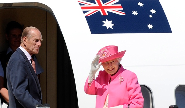 Queen Elizabeth II and Prince Philip board a plane in Melbourne, Australia, on Oct. 26, 2011. (AP / Andrew Brownbill)