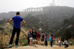 Tourists take their pictures with the Hollywood Sign in the background, Tuesday, Jan. 20, 2015, in Los Angeles. (AP Photo/Jae C. Hong)
