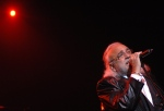 In this Tuesday Sept. 29, 2009 file photo, Greek pop singer Demis Roussos, the singer of former pop band Aphrodite's Child in the 1970s, performs during his concert in the Papp Laszlo Arena in Budapest, Hungary. (AP Photo/MTI, Peter Kollanyi)